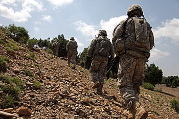 English: In this file photo, Soldiers patrol a...