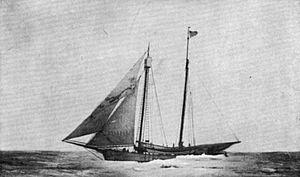 English: Trading schooner in ice. Jibs set.