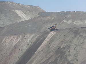 Giant truck unloading tailings from the Chuqui...