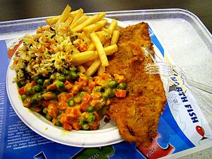 English: cod with fries and salad with carrots...