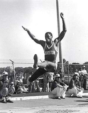 Carl Lewis in midair during a long jump for tr...