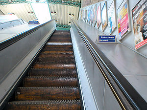Going up the last wooden escalator on the Lond...