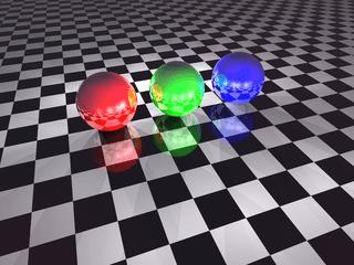 Tres esferas, reflejándose en el suelo y unas en otras