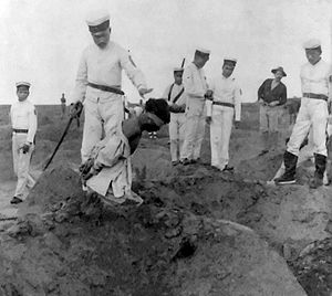 Japanese executioner prepares to behead a cond...