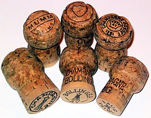 6 Champagne Corks. On front row (from left to ...