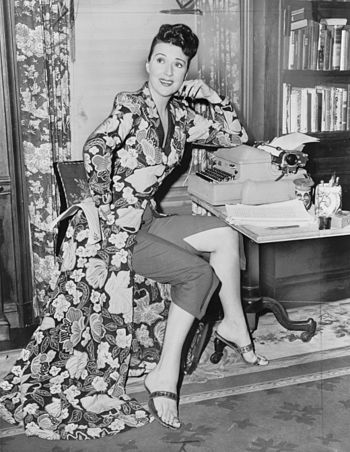 Gypsy Rose Lee, full-length portrait, seated a...