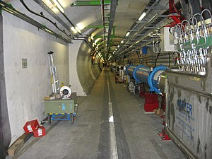 Large Hadron Collider tunnel and dipole magnets.