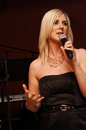 Tara Hunt giving a speech at a wedding.