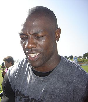 English: Terrell Owens (T.O.) autographing for...