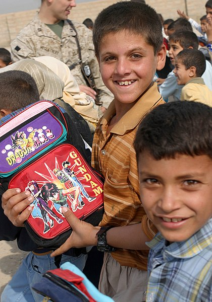 File:US Navy 041026-M-1250B-009 Iraqi children receive school supplies from U.S. Marines and Sailors assigned to the 24th Marine Expeditionary Unit (MEU) during a Back-to-School campaign.jpg