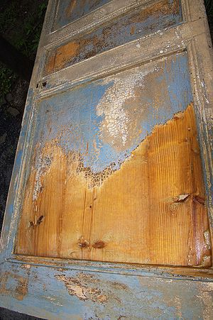 Partial paint stripping of an old wood door us...