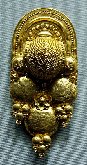 Earring decorated with bosses, globule cluster...