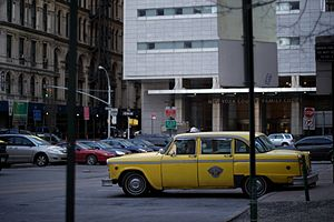 English: A checker taxi cab in front of the Ne...