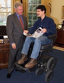 wheelchair meaning in urdu folding beach chair motorized wikipedia former us president bill clinton dean kamen and the ibot