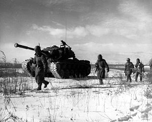 A column of troops and armor of the 1st Marine...