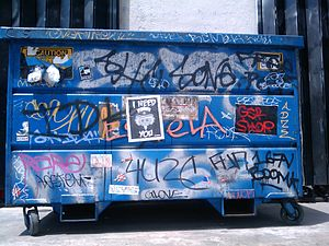 English: Dumpster with extensive graffiti, dow...