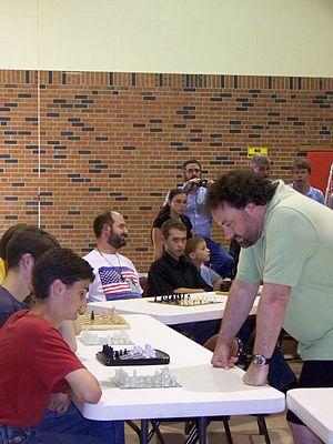 English: Jonathan Sarfati (right) playing ches...