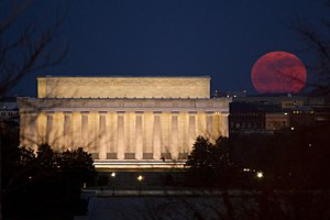 The full moon is seen as it rises near the Lin...