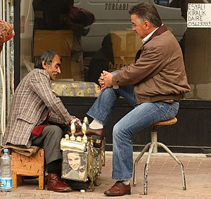 Getting a sidewalk shoeshine in Gelibolu, Turkey