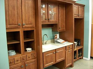 Kitchen cabinets are sold as integrated sets w...