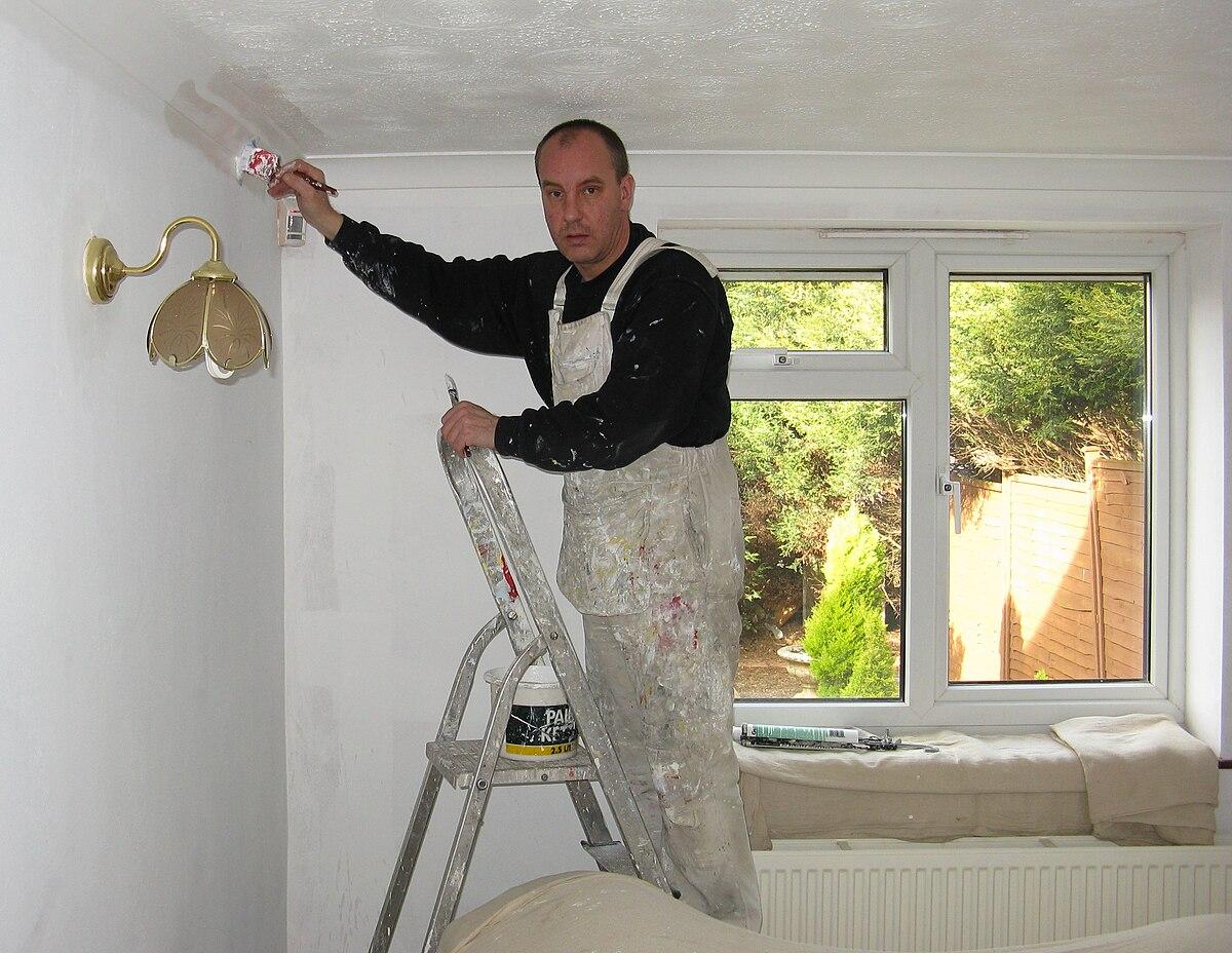 Painter paints a room arp.jpg