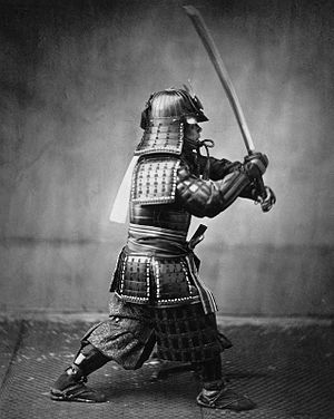 English: Armoured samurai with sword and dagge...