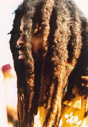 Rastaman with thick dreadlocks, though he has ...