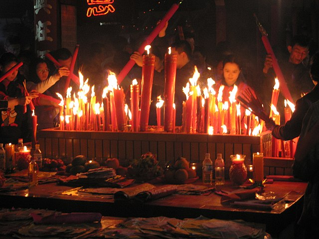 Chinese New Year eve (8 February 2005, 22:59:06) in Meizhou at eastern Guangdong province, China. Fireworks are set off to ward off the bad spirits from the previous year and welcome the new year in. Candles and incense are also lighted during prayers, like this scene on Chinese New Year's Eve.
