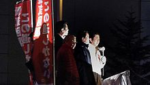 Prime Minister Abe giving a speech in front of the Gundam Cafe in Akihabara, 2014.