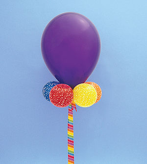 "English: purple latex balloon 24"" in diam..."