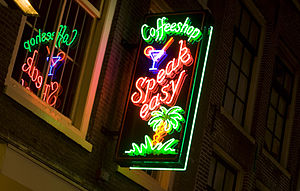 A view of a neon sign of a cannabis coffee sho...