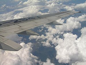 English: Cumulus clouds viewed on a plane from...