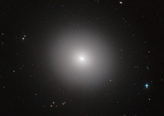 This NASA/ESA Hubble Space Telescope image shows an elliptical galaxy known as IC 2006. Massive elliptical galaxies like these are common in the modern Universe, but how they quenched their once furious rates of star formation is an astrophysical mystery. Now, the NASA/ESA Hubble Space Telescope and ESO's Very Large Telescope (VLT) have revealed that three billion years after the Big Bang, these types of galaxies still made stars on their outskirts, but no longer in their interiors. The quenching of star formation seems to have started in the cores of the galaxies and then spread to the outer parts.