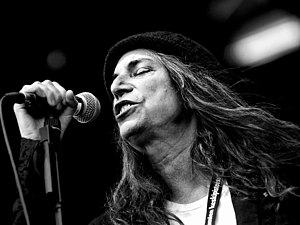 Patti Smith singing into a Shure SM58 (dynamic...