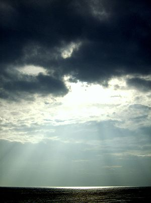 The sunlight shining through these clouds in E...