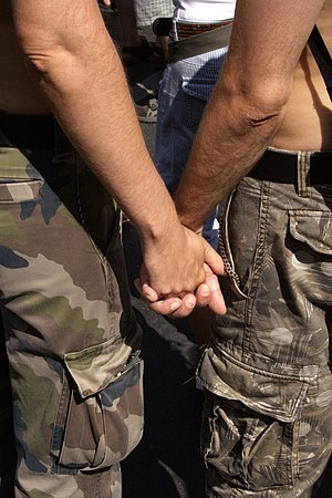 Gay Couple in Military pants holding hands on ...