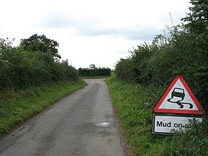 English: Mud on the Road The sign on Hulver Ro...