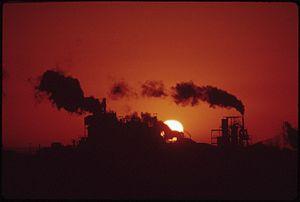 SETTING SUN AND SMOKESTACKS - NARA - 544708