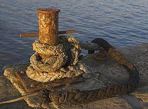 English: Mooring bollard at sunset, Lyme Regis...