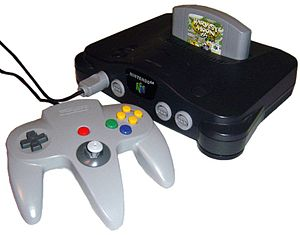 A Nintendo 64 game console and controller (Nin...