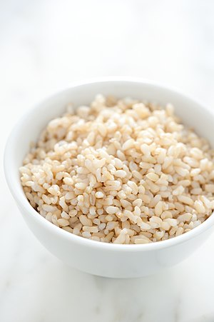 English: Par cooked brown rice.