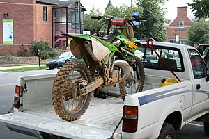 Dirt bike fixed to a truck bed on Franklin Str...