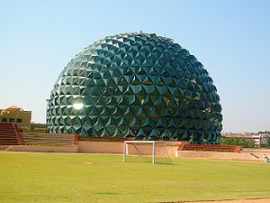 This is a building shaped like a sphere, locat...