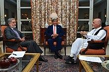 President Ahmadzai sitting with Abdullah Abdullah and John Kerry in July 2014