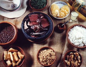 Feijoada with several accompaniments: rice cas...