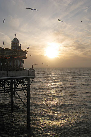 English: Low Sun at Palace Pier, Brighton Abou...