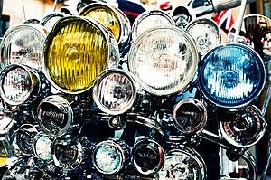 Headlight overkill on an Italian scooter.