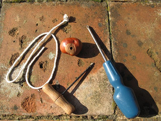 Stringing a conker, according to the Wikipedia