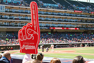 A fan raises a foam hand at a Cleveland Indian...
