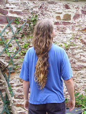 English: Male long hair in Western culture. To...
